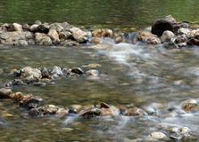 Stream water with rocky bottom Royalty Free Stock Images