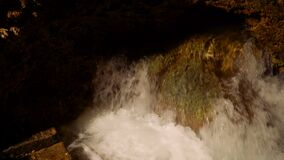 Stream of water in cave. Stream of water undeground river in Jatijajar Cave, Kebumen, Indonesia stock video footage