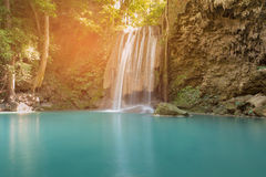Stream waterfall green colour water in tropical forest national park Stock Photos