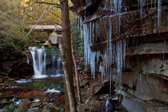 Stream, waterfalls and icicles in the mountains Stock Photos