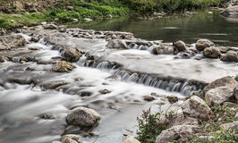 Stream and waterfalls. Long exposure water on torrent river Royalty Free Stock Photo
