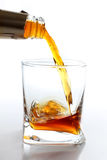 Stream of whiskey Stock Photography