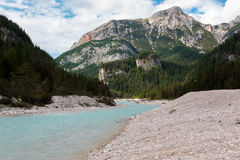 Stream with White Pure Water and Mountains Peaks in background Royalty Free Stock Images