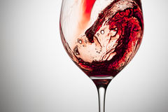 Stream of wine being pouring into a glass. Royalty Free Stock Images