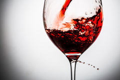 Stream of wine being pouring into a glass. Stock Image