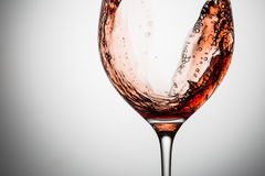 Stream of wine being pouring into a glass. Royalty Free Stock Image