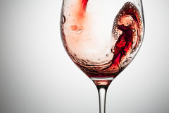 Stream of wine being pouring into a glass. Stock Photography