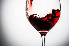 Stream of wine being pouring into a glass. Royalty Free Stock Photography