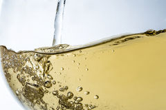 Stream of wine being pouring into a glass closeup, wine, splash, bubbles, fizz Royalty Free Stock Photos