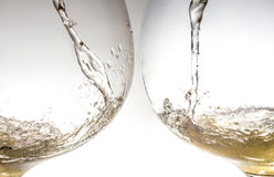 Stream of wine being pouring into a two glasses closeup, wine, splash, Stock Images