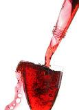 Stream of wine from the bottle into the glass. Stock Photography