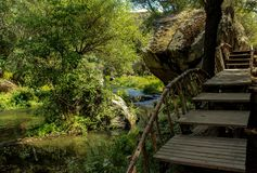 Stream and Wooden steps royalty free stock images