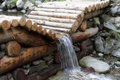 Stream in the woods. Dam of wood in a mountain stream Royalty Free Stock Photos
