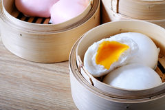 Streamed chinese buns, Dim Sum in round bamboo crate Stock Image