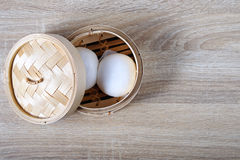 Streamed chinese buns, Dim Sum in round bamboo crate Stock Photos