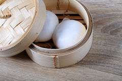 Streamed chinese buns, Dim Sum in round bamboo crate Royalty Free Stock Images