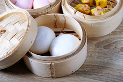 Streamed chinese buns, Dim Sum in round bamboo crate Stock Photography