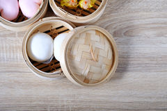 Streamed chinese buns, Dim Sum in round bamboo crate Royalty Free Stock Image