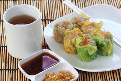 Streamed Dumpling and cup of Tea Stock Photos