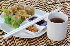 Streamed Dumpling and cup of Tea Stock Photo