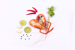 Streamed large prawns in heart shape and spicy sour herb. Stock Photo