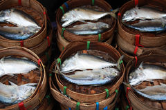 Streamed mackerel in bamboo basket. In the wet market Stock Images