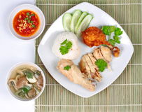 Streamed,oily rice,deep fried,chicken,red hot chili pepper,tofu, soy bean ,sauce,mushroom,soup,cucumber,popular asia food.chicken Royalty Free Stock Image