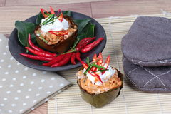 Streamed vegetable curry in banana leaf cup call 'Hor Mok J' is spicy Thai organic food. Royalty Free Stock Photos