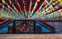 Streamer and buddhist murals Royalty Free Stock Photography