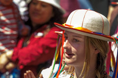 Streamers. Woman in costume participating in Pase del Niño parade, Cuenca, Ecuador, December 24, 2013 Stock Image