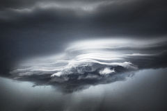 Streamers of cloud beneath the leading edge of a storm front forms abstract patterns in muted colours Royalty Free Stock Photos