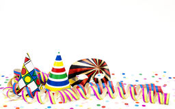 Streamers and coloured hats Stock Photos