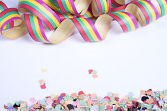 Streamers and confetti for carnival on white background Royalty Free Stock Images