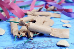 Streamers, confetti and firecrackers on a rustic blue wooden sur Stock Photo