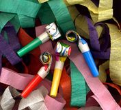 Streamers and party whistles Stock Photos