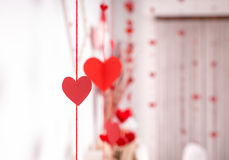 Streamers of red hearts hanging on ribbons. Decorating a wedding venue and reception symbolising love and romance royalty free stock photo