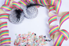 Streamers with two glittering carnival heads on white Royalty Free Stock Photography