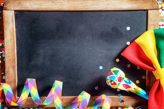 Streamers, Whistle and Ribbon in Front Black Board Royalty Free Stock Photo