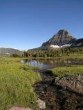 Streaming Reflect. Mountain lake royalty free stock image