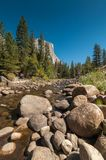 Streaming river in Yosemite National Park underneath the El Capitan rock Stock Image