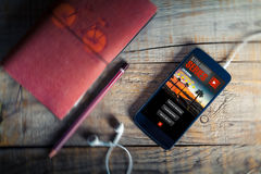 Streaming series app service in a mobile phone screen. Video app in a mobile phone screen royalty free stock photography