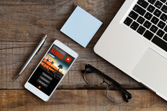Streaming series app service in a mobile phone screen. Royalty Free Stock Photography