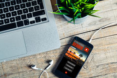 Streaming series app service in a mobile phone screen. Video app in a mobile phone screen royalty free stock photos