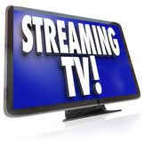 Streaming TV HDTV Set Online Internet Television Viewing. The words Streaming TV on an HDTV television set to illustrate downloading or pirating of programming Royalty Free Stock Photos