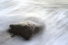 Streaming Water on Black Stone Stock Images