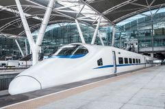 High speed train in China   railway station. Streamlined high speed bullet train arriving at  railway station in China Royalty Free Stock Photos
