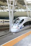 High speed train in China. Streamlined high speed bullet train arriving at Shanghai railway station in China Royalty Free Stock Photos