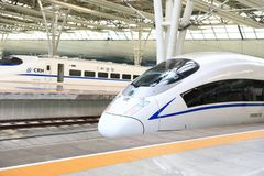 High speed train in China. Streamlined high speed bullet train arriving at Shanghai railway station in China Stock Photography