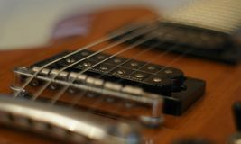 Streams and Bridges. Closeup shot of Washburn Idol WI-64 electric guitar with Tune-o-matic bridge stock image
