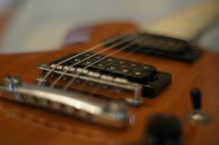 Streams and Bridges. Closeup shot of Washburn Idol WI-64 electric guitar with Tune-o-matic bridge royalty free stock photos